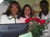 owner-dr-corlis-johnson-employees-maria-villafuerte-greg-christie-med-600x450