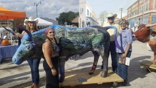 April. Here is myself with my wife Marcia at the rear of our bull. At the head is Michelle Turner who organized the event and in front is Monica Goodwin Turner the artist who painted the bull. Let me know if you need anything else. Thanks